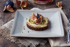 Sabra Classic Hummus Toast with Figs, Smoked Honey and Pistachios